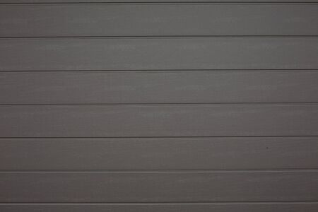 Gray plastic planks imitating wood wall pattern background