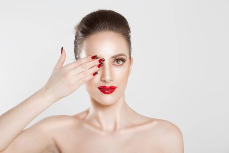 Sexy Beauty Girl with false eyelashes Black Red gradient Lips, Nails. Provocative natural Make up. Luxury Woman looking at you camera hand on face Fashion Brunette Portrait isolated white background