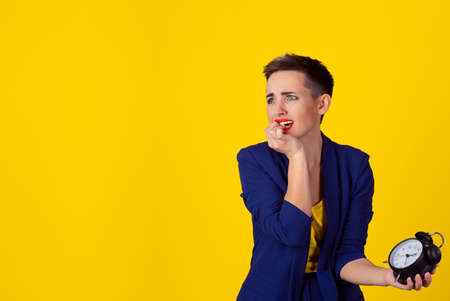 Woman being late. Closeup portrait headshot view stressed young attractive beautiful businesswoman checking the time being late to a business meeting to a rendez-vous, date isolated yellow background