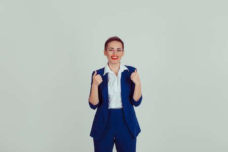 Close up of female entrepreneur giving thumbs up against a light green background Reklamní fotografie
