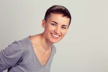 Smiling Young business woman with short hair