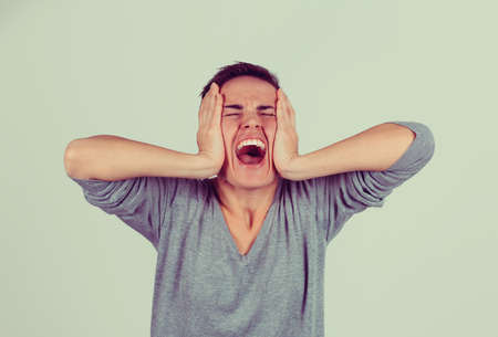 Stressed angry woman yelling screaming has temper tantrum isolated light green gray background. Negative human emotion facial expression reaction attitude Stok Fotoğraf