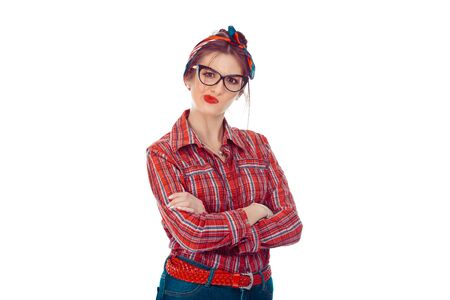 Skeptical young lady, woman looking suspicious, some disgust on face mixed with disapproval. Closeup portrait of beautiful girl in red checkered shirt, jeans with retro bow on head isolated on white