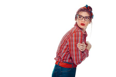 Nervous scared neurotic woman looking back. Closeup portrait of a beautiful girl in red checkered shirt and jeans with retro bow on head isolated on white background. Mixed race, hispanic, caucasian
