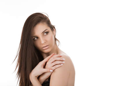 Natural beauty. Closeup portrait image of a woman cute brunette beautiful female, lady, cute girl looking to the side posing isolated on pure white studio wall background. Positive face expression Banco de Imagens