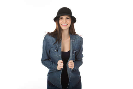 Woman smiling at camera happily, cute hipster girl in black hat posing looking cheerful at you isolated on white studio wall background. Positive face expression, human emotion.