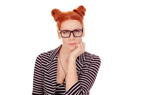Grumpy wife. Closeup portrait of upset woman in her 30s wearing striped black and white jacket with 2 buns up hairdo standing on pure white background wall. Mixed race, Irish Hiispanic Caucasian model