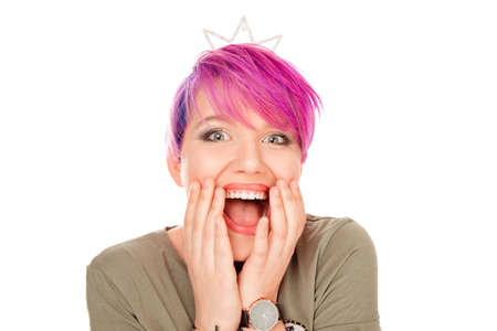 Surprise astonished woman. Closeup portrait funny girl with party crown looking surprised in full disbelief wide open mouth isolated white background. Positive emotion facial expression body language
