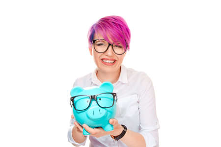 Happy woman excited over savings on buying eyeglasses. Piggy bank and girl wearing glasses isolated on white background. Ophthalmology finances savings concept. Positive facial expressions, emotions.
