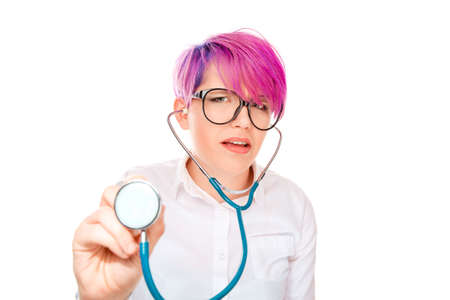 Closeup portrait young suspicious skeptical crazy female doctor psychiatrist looking funny, holding stethoscope pessimistic craving anxious isolated white background. Human facial expressions emotions