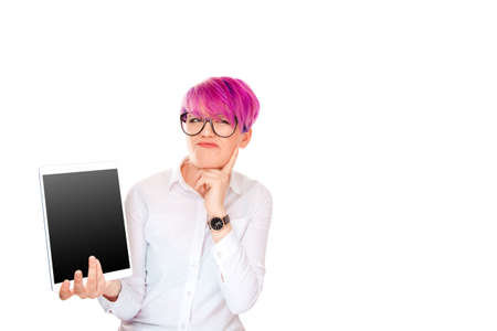 Portrait upset sad skeptical unhappy serious woman holding mobile pad tablet computer displeased with email news she received isolated white background. Negative human emotion face expression feeling
