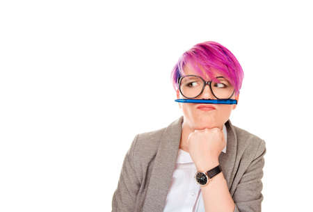 ADHD. Annoyed woman funny student corporate employee playing holding pen between nose and lips as mustache looking to the side thinking playful bored after working long hours isolated white background