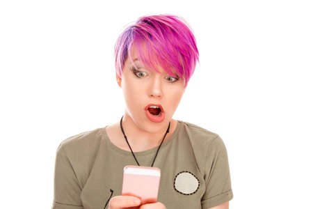 Female  freelance worker woman being disappointed with news from colleague, reads message on smartphone, shocked by the bad news she received ugly pictures on social media isolated on white background 免版税图像