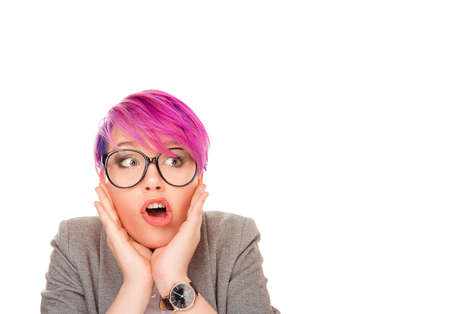 Wow. Closeup portrait young woman beautiful girl with pink hair looking excited to side holding her mouth opened, hands on cheeks isolated on white background. Shocked surprised stunned. Human emotion