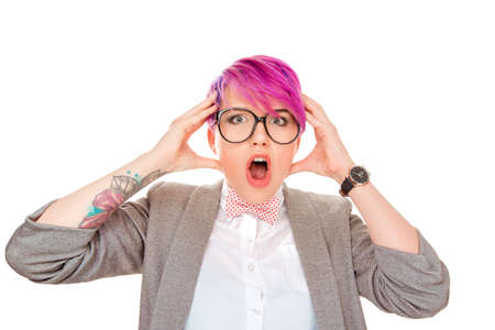 Closeup portrait of surprised young handsome pink hair business woman looking shocked in full disbelief hands on head open eyes with glasses isolated white background. Positive human facial emotion