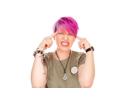 Waist up portrait of shocked frustrated fashionable young woman stressed woman hands on head standing on white studio wall having stressed going crazy nuts expression on her face. Funny girl in stress
