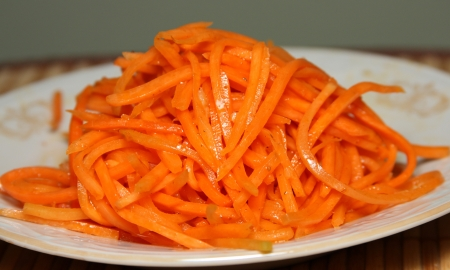 The cut bright carrots on a plate photo