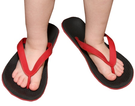 children s feet: children s feet are put in footwear for adults