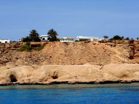 nhabited constructions on the sandy seashore photo
