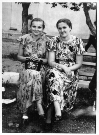 represents: Red Beam, the USSR - CIRCA 1970th: the photo made in the USSR, represents two girlfriends, sitting on a shop, circa 1970th. Editorial