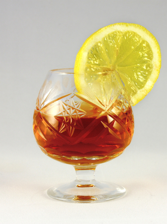 shots alcohol: cognac in a glass with a lemon