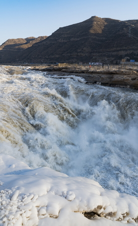 icefall: Yichuan County, Shaanxi Province, Chinese, Hukou Waterfall is the worlds largest yellow falls. Into the winter, gradually formed yellow icefall, spectacular.