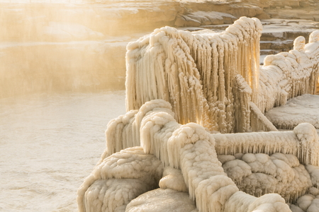 Yichuan County, Shaanxi Province, Chinese, Hukou Waterfall is the worlds largest yellow falls. Into the winter, gradually formed yellow icefall, spectacular.