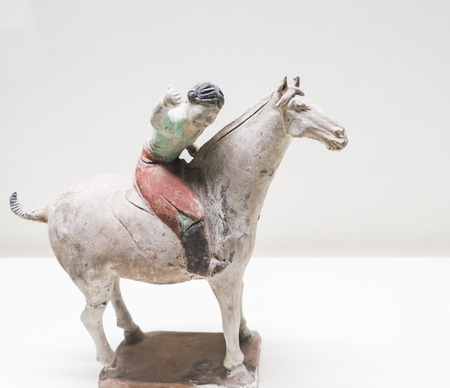 The ancient sports relics Hu people playing polo from Tang Dynasty, Tianjin Museum, Tianjin, China.