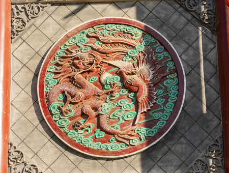 China, Henan Province, Kaifeng City, Qingming Shanghe Garden, painted brick carving dragon and phoenix 版權商用圖片