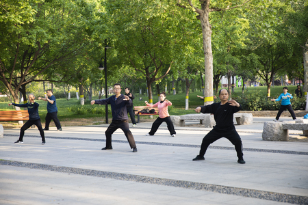 Citizens practicing Tai Chi in the park, Shijiazhuang City, Hebei Province, China Editorial