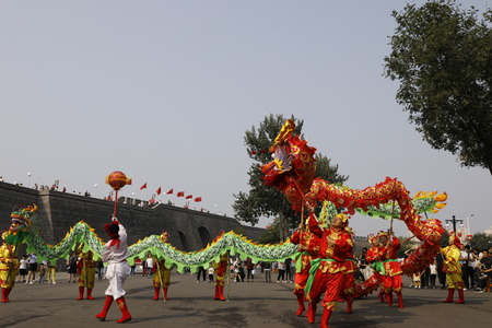 China, Hebei Province, Shijiazhuang City, Zhengding Ancient City with citizens drum performing to celebrate National Day