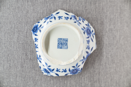 China, Hebei Province, Shijiazhuang, Hebei Provincial Museum, Unearthed Cultural Relics Exhibits from Yuanmingyuan, Qing Dynasty, Blue and White Flower and Grass Pattern Plate 新聞圖片
