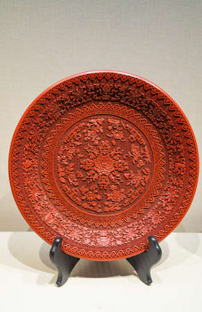 China, Henan Province, Kaifeng City, Kaifeng Museum, collection of cultural relics, Qing Dynasty, red lacquer goulian eight-treasure flower disc Stock fotó - 154912762