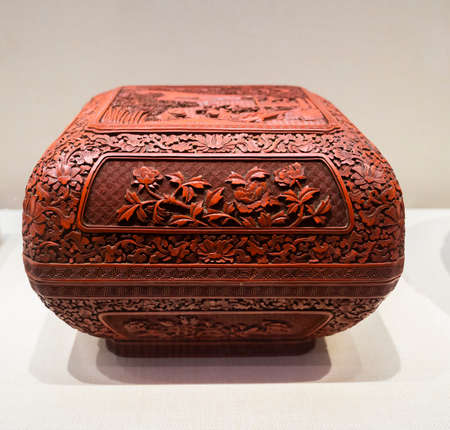 China, Henan Province, Kaifeng City, Kaifeng Museum, collection of cultural relics, Qing Dynasty, red carving lacquer, landscape figures, flowers, square corner box Stock fotó - 154912764