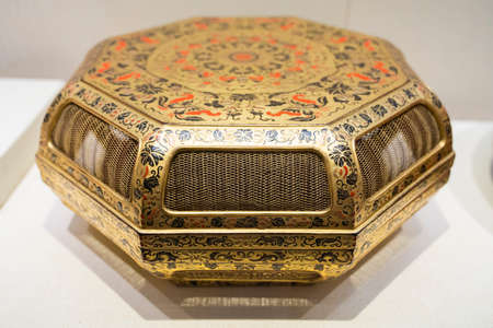 gold lacquer painted colorful Fushou flower and fruit hollow box from Qing Dynasty at Kaifeng Museum, Kaifeng City, Henan Province, China. Sajtókép
