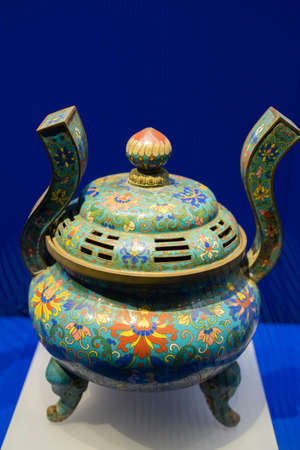 enamel-inlaid Bagua elephant foot furnace from Qing Dynasty at Kaifeng Museum, Kaifeng City, Henan Province, China.