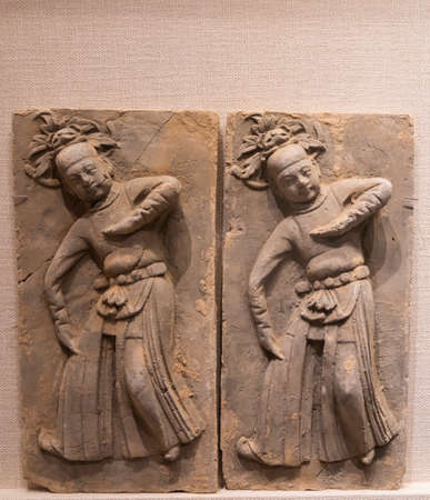 ceramic tiles with relief dancing figures from Song Dynasty at Kaifeng Museum, Kaifeng City, Henan Province, China.