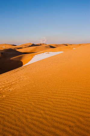 Sand dunes with blue sky Stock Photo