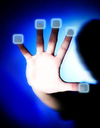 A silhouette boy pushing an access button. Stock Photo
