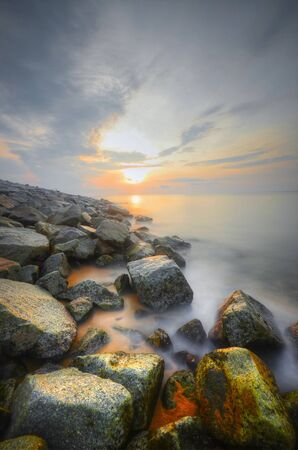 View of morning sunrise at the beach on slow shutter technic