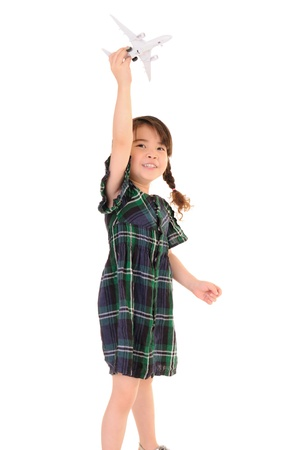 Cute little girl play with toy airplane on white background  Stock Photo