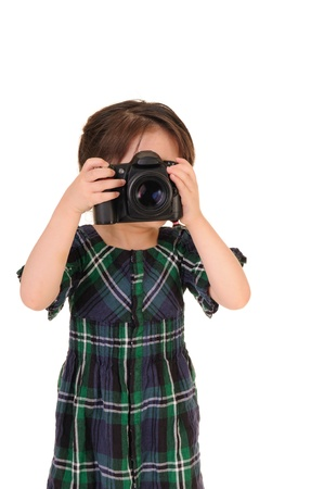 Little girl with an old camera  Studio shot