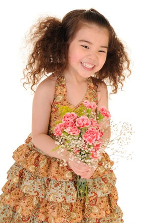 Happy little girl holding a bouquet of carnations  Isolated on white background