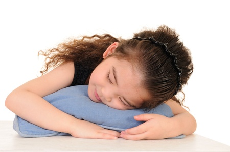 Cute kid lying on a green star-shaped pillow  Stock Photo