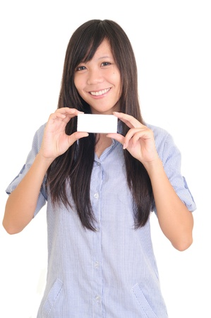 Portrait of a happy young woman with bussiness card against white background  Stock Photo - 13603875