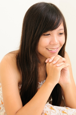 Young chinese girl squatting Stock Photo - 13603704