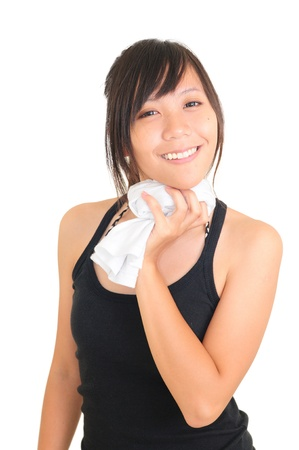 Smiling fit girl holding towel Stock Photo - 13603713