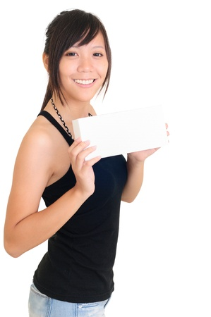 Portrait of a happy young woman with bussiness card against white background  photo