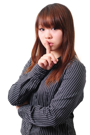 hand over: Shhhhh  Asian gesturing on white background   Stock Photo