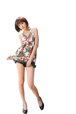 young girl wearing a jeans shorts and top isolated on white  photo
